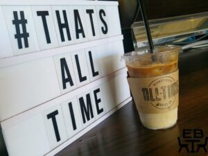 "Image of Coffee in a cup in front of sign that says ""Thats All Time"" at All Time Coffee, Mermaid Beach"