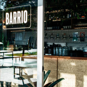 Looking through the front window of Barrio, Byron Bay where seating and a bar are located