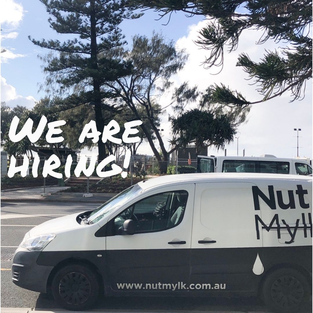 """NUTMYLK van parked in front of beach with """"we are hiring"""" on photo"""